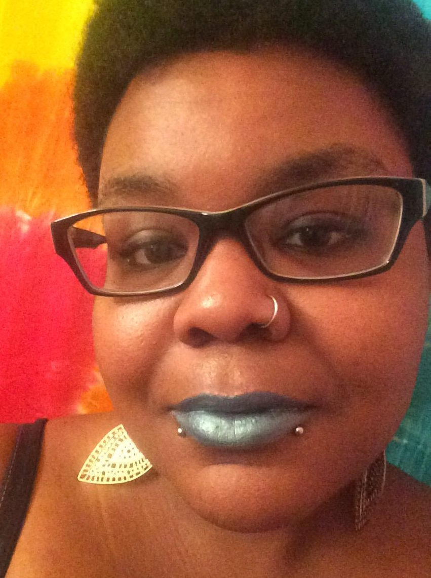 close up image of mat talton wearing glasses and smiling